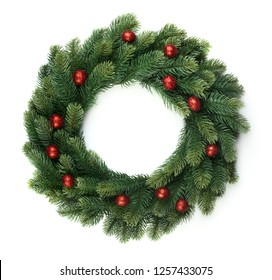 Christmas fir wreath with red balls isolated on white background