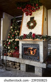 Christmas fireplace with decorated christmas tree
