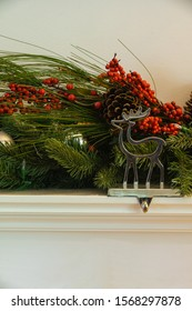 Christmas fireplace hanger reindeer with green garland cherry and bauballs vertical
