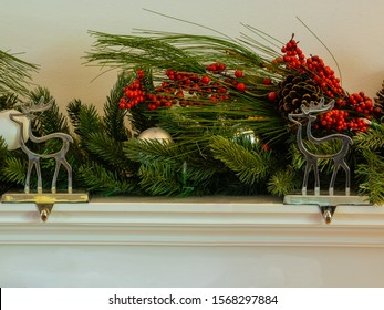 Christmas fireplace hanger reindeer with green garland cherry and bauballs panorama