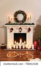 Christmas fireplace with Santa socks. Christmas stocking hanging from a mantel or fireplace, decorated for Christmas with fire glowing. New year design.