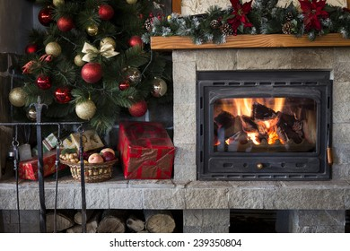 Christmas fireplace and tree decorated with baubles