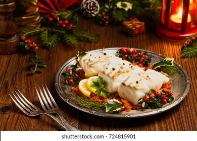 christmas fish roasted cod pieces served in vegetable sauce xmas styling front