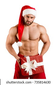 Christmas fitness white guy wearing Santa Claus hat with muschular body and big gift box, isolated