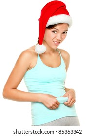 Ariwasabis christmas fitness diet weight loss set on shutterstock christmas fitness woman funny weight loss concept of fit young woman showing her belly fat ccuart Gallery