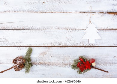 Christmas flat lay minimal with white wood trees on white board wood table with ornaments