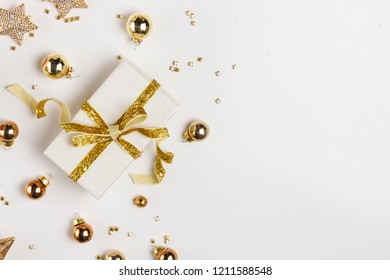 Christmas flat lay scene with golden decorations