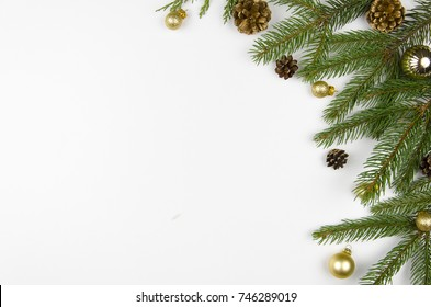 Christmas flat lay styled scene with evergreen tree twigs, Christmas decorations and copy space
