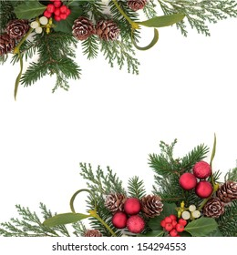 Christmas floral background border with red baubles, holly, ivy, mistletoe, pine cones and winter greenery over white background.