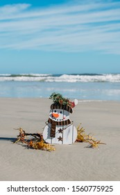 Christmas in Florida theme. Frosty the snowman on New Smyrna Beach, Florida.