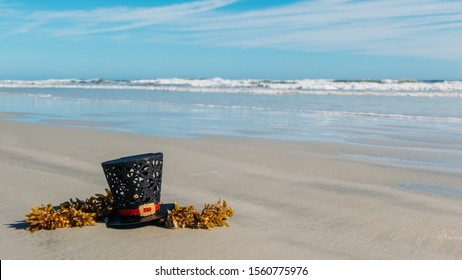 Christmas in Florida theme.  Frosty the snowman's hat on the shores of New Smyrna Beach Florida.