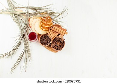 Christmas food background - mulled wine. Decorative border of  spices and drinks on white wood board. Top view. Cooking of  beverage.