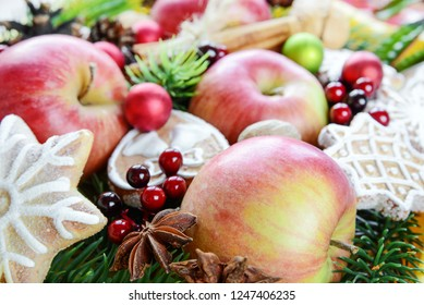 Christmas food background from the red apples, cookies and spices