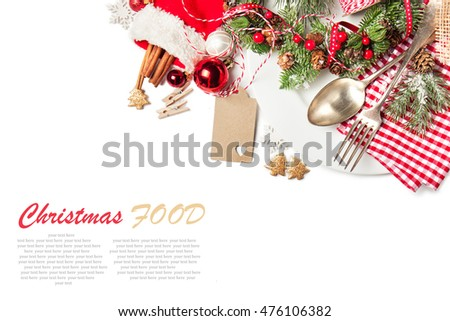 Christmas food concept - plate with fork and spoon with christmas decoration, top view, isolated with sample text
