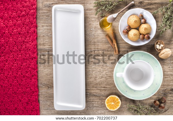 Christmas food and drink mock up. Hot tea, cinnamon cookies, walnuts, honey, orange, thyme. Christmas, new year, winter concept. Flat lay, top view, mockup. design for restaurant menu.