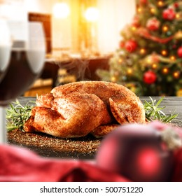 christmas food on table and interior of kitchen room with xmas tree