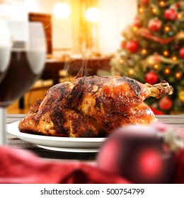 christmas food on table and interior of kitchen with xmas tree