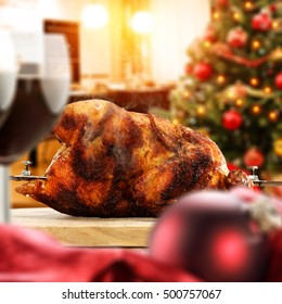 christmas food on table and interior of xmas tree in kitchen