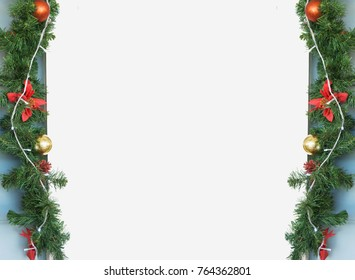 Christmas frame background decor with fir tree and ball with white copy space on the center.