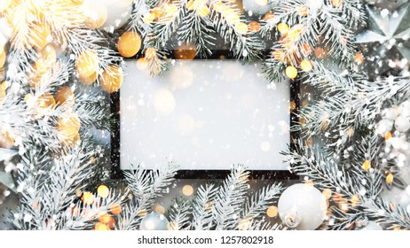 Christmas frame background with xmas fir tree and xmas decorations. Merry Christmas greeting card, banner. Winter holiday theme. Happy New Year. Noel. Space for text. Flat lay