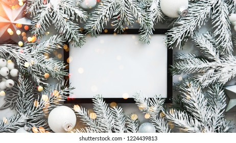 Christmas frame background with xmas tree and xmas decorations. Merry Christmas greeting card, banner. Winter holiday theme. Happy New Year. Noel. Space for text. Flat lay