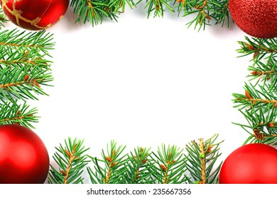 christmas frame of the branches of spruce on a white background