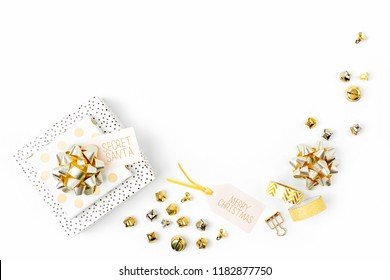 Christmas frame. Christmas decorations and gifts in gold colors on white background with empty copy space for text. Holiday and celebration. Flat lay, top view