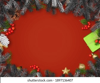 Christmas frame with gift box, paper decorations, spruce branches and berries on red background.