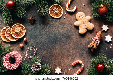 Christmas frame with gingerbread cookies, Christmas fir tree, pine cones, spices and toys. Copy space for text. Winter holidays background mock up