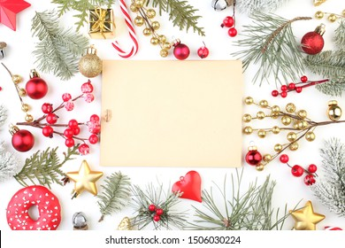 Christmas frame with retro style paper card and colorful winter season fir branch, red holly berries, golden stars, gifts and baubles on white background