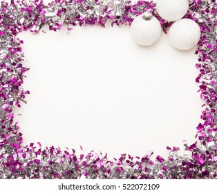 Christmas frame with silvery tinsel and white Christmas balls