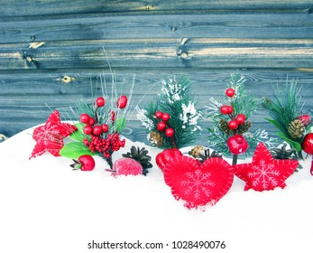 christmas fruit berries apple and decoration with fir branches snow