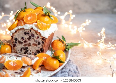 Christmas fruit cake decorated with a clementines