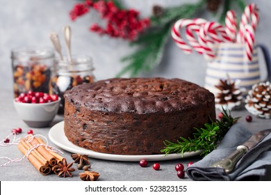 Christmas fruit cake, pudding on white plate. Copy space. Close up.