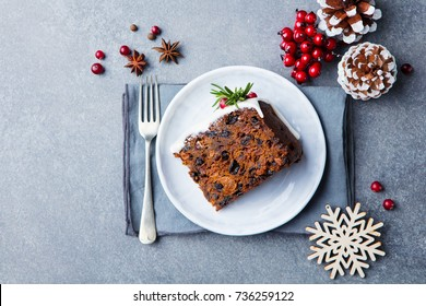 Christmas fruit cake, pudding on white plate. Top view.