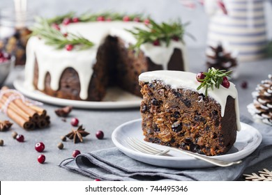 Christmas fruit cake, pudding on white plate. Christmas decoration. Close up.