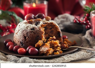 Christmas fruit pudding on a plate. Traditional xmas english cuisine