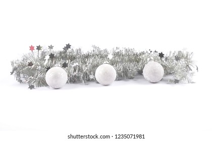 Christmas garland and baubles on white