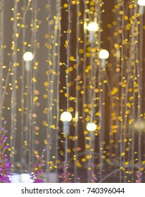 Christmas garland beautifully lit in the distance. The picture is blurred, there was a beautiful bokeh.