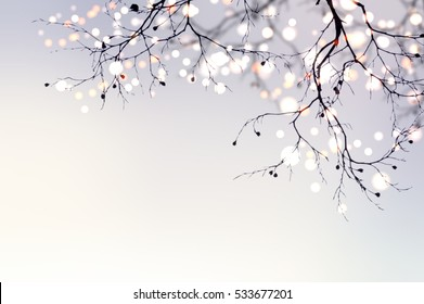 Christmas garland glitters and sparkles on a tree branch. Festive blurred background. Light abstract pearl matte texture.