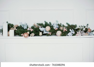 Christmas garland with golden and pink decorations