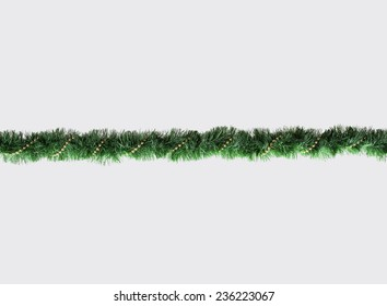 Christmas Garland isolated on Grey Background. Top View of Xmas Decoration Close-Up with Text Space