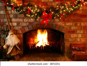 Christmas garland and lights over a log fire, with Santa as a helper.
