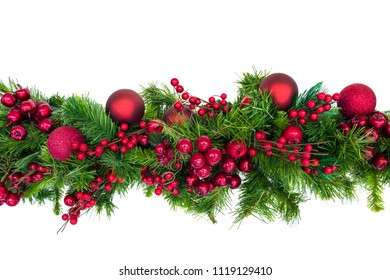 Christmas garland with red berries and baubles, isolated on white.