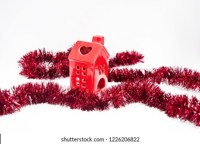 Christmas garland with red house. Abstract isolated photo on white background.