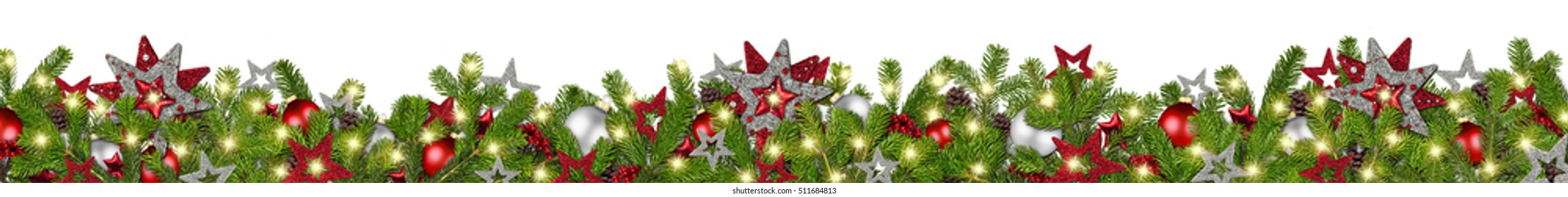 christmas garland super wide panorama banner with fir branches red silver stars lights and baubles xmas decoration isolated on white background
