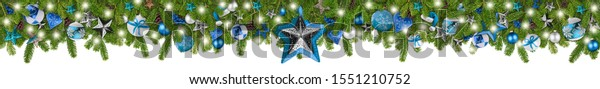 christmas garland super wide panorama banner with fir branches blue turquoise and wooden silver stars lights and baubles xmas russtic traditional natural tree decoration isolated on white background