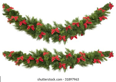 Christmas garlands decorated with red velvet bows, isolated on white.  One garland is straight, and the other curved.