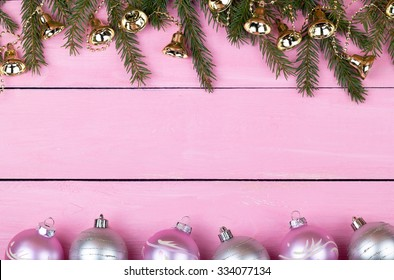 Christmas garlands on a pink wooden background with a place for your text