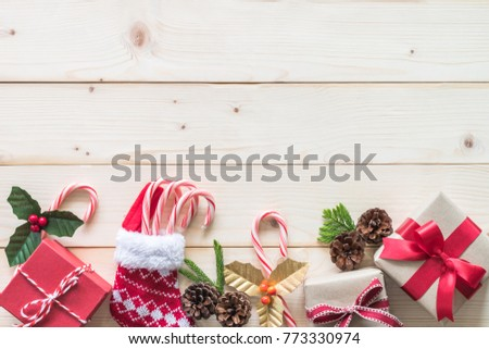 christmas gift background with red box of present on white pine wood background for x